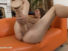 Hungry brunette milf sucks on a big dildo as the other fills her