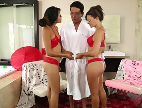 Two Asians while his blonde wife watching